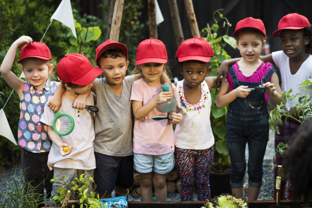 $2https://springchildcare.co.uk/wp-content/uploads/2021/08/Children-playing-outside-with-red-hats-on-1024x683.jpg